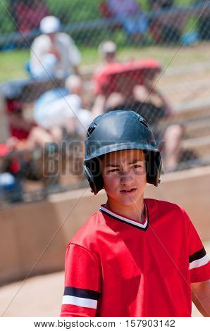 Youth baseball boy ready to bat looking confident.