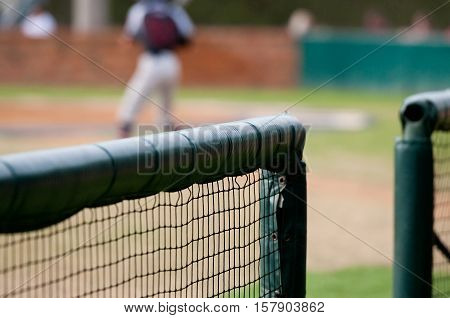 Close up of a baseball dugout net