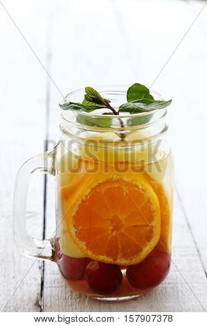 Macro watered glass in fruity water, food and drink