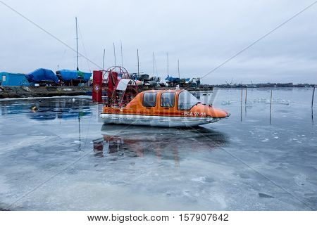 ARKHANGELSK, RUSSIA - APRIL 14, 2014: Hovercraft. Cushioncraft of emercom. Parking on the weak ice.