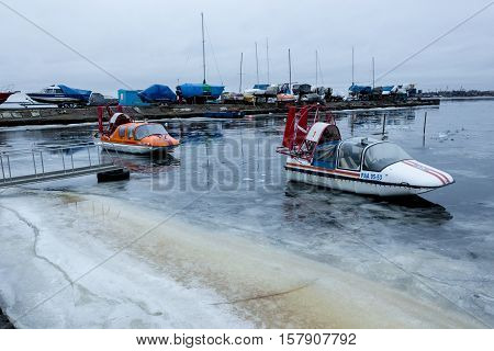 ARKHANGELSK, RUSSIA - APRIL 14, 2014: Hovercrafts. Cushioncrafts of emercom Parking on the weak ice