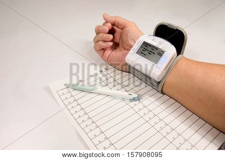Person who measures with wrist type sphygmomanometer