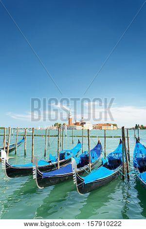 Several Gondolas Parked Beside The Riva Degli Schiavoni, Venice