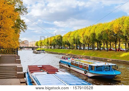 SAINT PETERSBURG RUSSIA-OCTOBER 3 2016. Water area of Moika river in autumn in Saint Petersburg Russia. City landscape of Saint Petersburg Russia with pleasure boats floating on Moika river