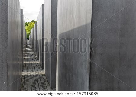 BERLIN GERMANY - JULY 2015: View of famous Jewish Holocaust Memorial near Brandenburg Gate in summer on July 27 2015 in Berlin Mitte Germany