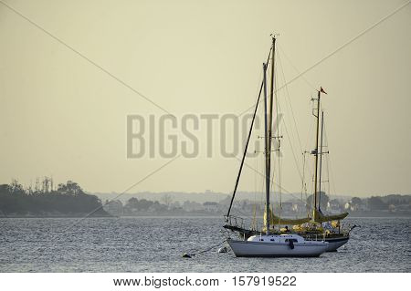 Tiverton Rhode Island USA - September 2 2010: Sailboats moored on the Sakonnet River on a hazy summer evening
