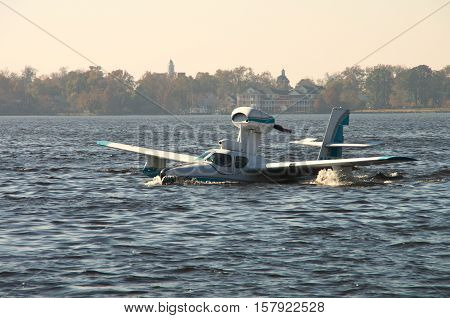 A Seaplane is just beggining to get into its take off run at a Festival in BridgetonNorthCarolina