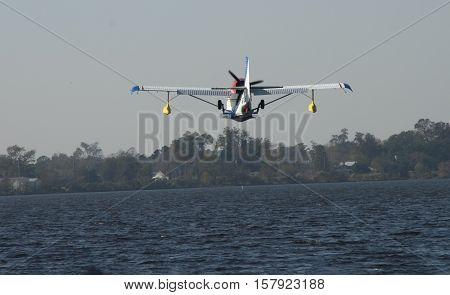 A Seaplane approaches the water for a landing at a festival in Bridgeton North Carolina
