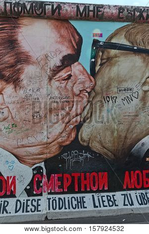BERLIN GERMANY - JULY 2015: Berlin Wall graffiti seen on JULY 26 2015 Berlin East Side Gallery. It's a 1.3 km long part of original Berlin Wall which collapsed in 1989.