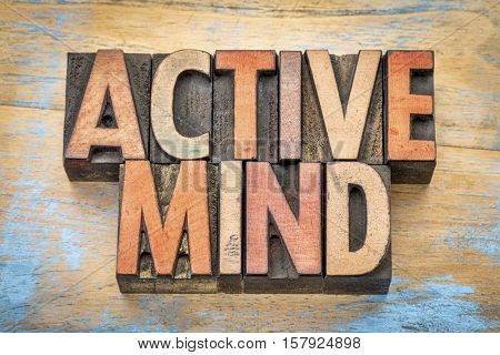 active mind  - word abstract in vintage letterpress wood type printing blocks