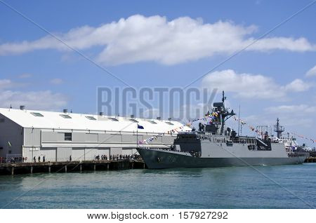 AUCKLAND - NOV 20 2016: HMNZS Te Kaha (F77) arrives at Auckland New Zealand as part of the NZ Navy's 75th birthday celebrations.