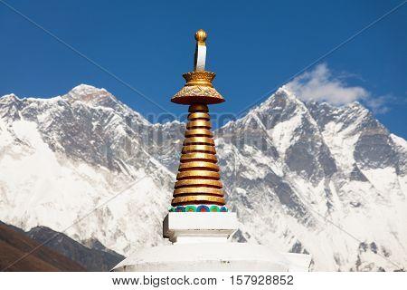 Stupa Lhotse and top of Everest from Tengboche monastery with beautiful sky - Way to Everest base camp Sagarmatha national park Khumbu valley Nepal