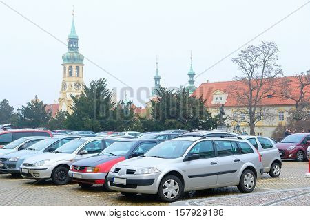 Car's parking on a street in the historical part of Prague, Czechia