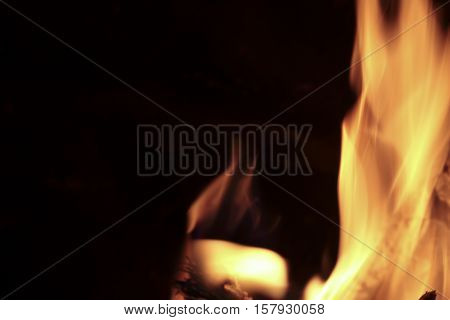 Flames Of Fire In A Fireplace.