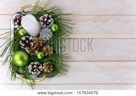 Christmas background with snowy pinecone decorated centerpiece. Christmas party decoration with green ornaments. Copy space.