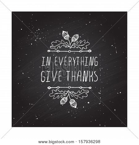 Handdrawn thanksgiving label with acorns and text on chalkboard background. In everything give thanks.