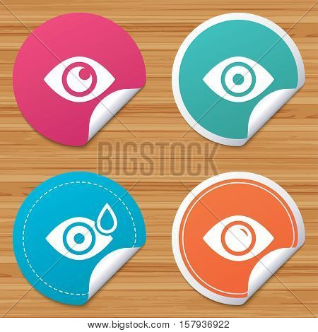 Round stickers or website banners. Eye icons. Water drops in the eye symbols. Red eye effect signs. Circle badges with bended corner. Vector