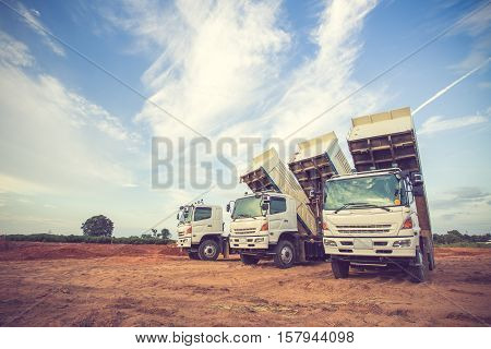 Construction Site Digger, Excavator And Dumper Truck. Industrial Machinery On Building Site.vintage