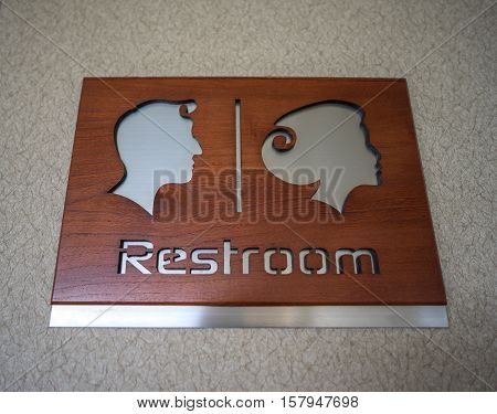 the rest room sign made from wood and aluminium
