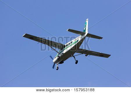 CHIANGMAI , THAILAND  FEBRUARY 19 2014: Cessna 208 Caravan of KASET, Bureau of Royal Rainmaking and Agricultural Aviation. Landing to Chiangmai Airport.