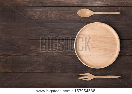 Eating Concept. Wood Dish, Wood Spoon And Wood Fork Set On The Wooden Background