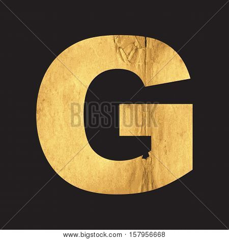 Uppercase letter G of the English alphabet carved out of the old paper on black vector