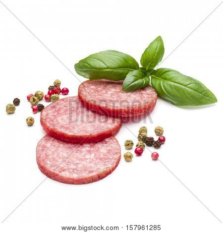 Salami smoked sausage three slices, basil leaves and peppercorns isolated on white background cutout