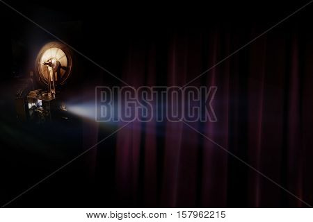 Old film projector with dark room background