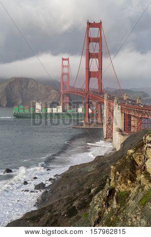 Stormy Skies on the Golden Gate Bridge. The Golden Gate Bridge and a Cargo Ship on a Rainy Day, San Francisco, California, USA.