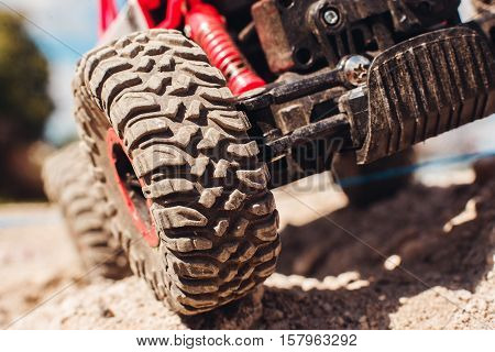 Wheels of off road car on rock landscape, close-up. Extreeme sport, adventure, safety concept