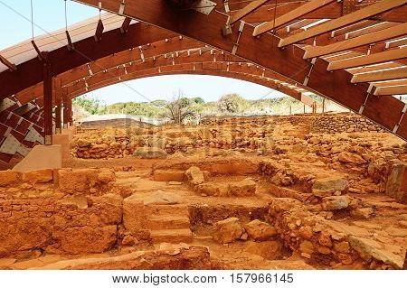 MALIA, CRETE - SEPTEMBER 14, 2016 - Ancient buildings within the Minoan Malia ruins archaeological site Malia Crete Greece Europe, September 14, 2016.