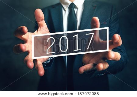 Business opportunity in 2017 elegant businessman with new year entrepreneurship resolutions
