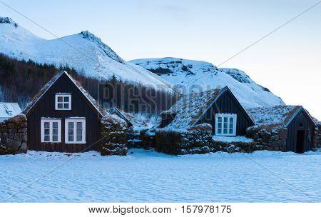 Icelandic turf houses at dawn in winter,  Skogar, Iceland.