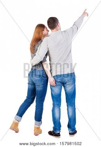 young couple pointing at wal Back view  (woman and man). Rear view people collection.  backside view of person.  Isolated over white background.