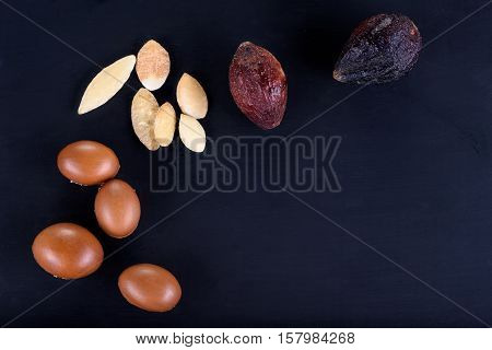 Close up of Argan fruits on a chalkboard