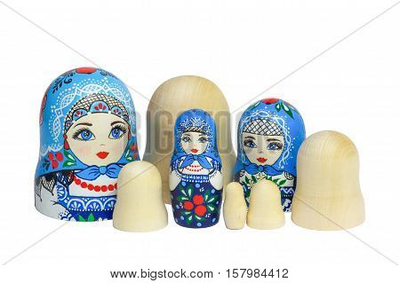 Three traditional Russian matryoshka dolls and blanks for painting dolls. Clean matryoshka.
