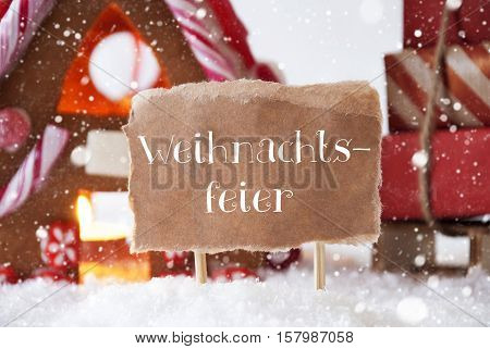 Label With German Text Weihnachtsfeier Means Christmas Party. Gingerbread House In Snowy Scenery As Christmas Decoration. Sleigh With Christmas Gifts Or Presents And Snowflakes.