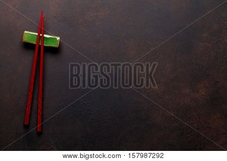 Sushi chopsticks on stone table. Top view with copy space