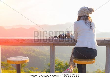 Woman Enjoy Drinks Drinks; She Was Relaxed And Enjoying The Natural Around Them.