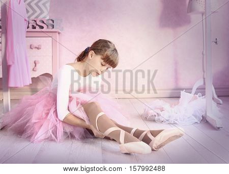 preteen girl in ballet class hall put on pointe shies prepare for classical dance lesson