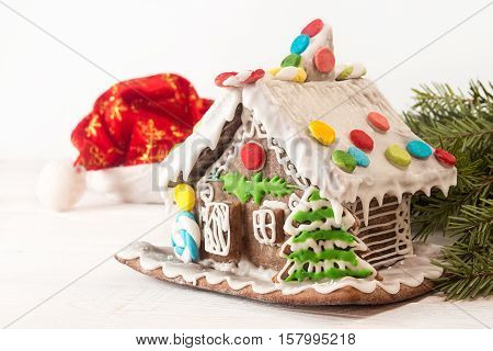 Christmas Gingerbread House, Hat Santa Claus On White