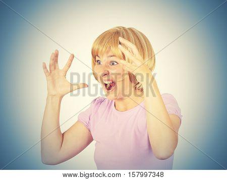 Young Woman Screams In Terror, Faces Portrait.