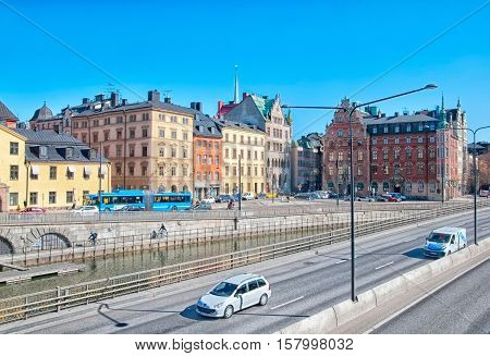 STOCKHOLM, SWEDEN - APRIL 14, 2010: Transport near Munkbron Square in Gamla Stan (Old Town). On the right side is Petersen House. On the left side is fragment of Ryning Palace