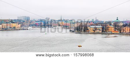 Stockholm, Sweden - April 11, 2010: Morning view of of the central part of the city with The Saltsjon Bay and Skeppsholmen Island. On the right side is the green roof of The Skeppsholmen Church (Now is Eric Ericsonhallen)