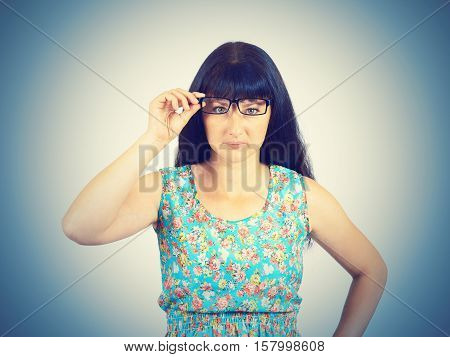 Young Women Look With Suspicion Through Her Glasses