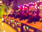Image of abstract blur Arcade game machine shop with bokeh for background usage . (vintage tone) poster