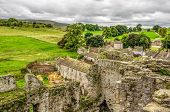 English countryside around Middleham, North Yorkshire, in late Summer. The castle is surrounded by green fields and trees and is a tourist attraction. poster