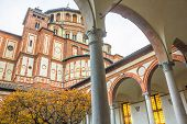 church Santa Maria Delle Grazie in Milan, Italy, from courtyard view. Hosting in it's refectory, The Last Supper mural painting by Leonardo da Vinci. side view poster