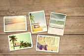 Photo album remembrance and nostalgia journey in summer surfing beach trip on wood table. instant photo of vintage camera - vintage and retro style poster