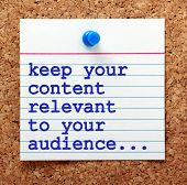 The phrase Keep Your Content Relevant to Your Audience in blue text on a note card pinned to a cork notice board as a reminder for your social media marketing strategy poster